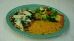 Pollo Campeche - Grilled chicken breast topped with spinach and cheese. Served with rice and grilled vegetables.